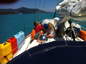 Lego on the deck anyone, arriving Airlie Beach township in the background.